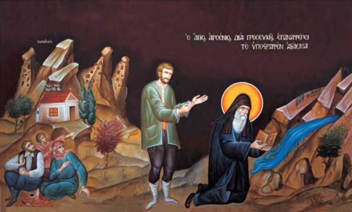 Святой Арсений извлекает воду из святого источника. Изображение на стене в трапезной монастыря апостола Иоанна Богослова в Суроти)