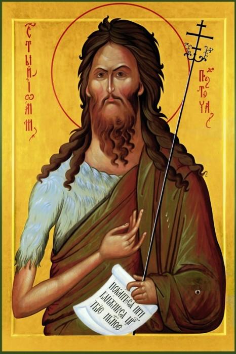 На иконах Иоанн Предтеча одет в верблюжью накидку, как описано в Библии. Свиток в руке — призыв к покаянию